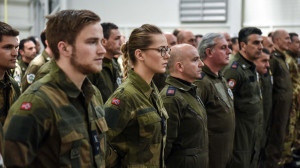 Norwegian soldiers stand to attention during the handover ceremony